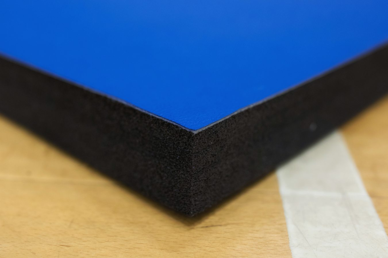 Corner of Blue Promat PVC Smooth Roll Out Mats