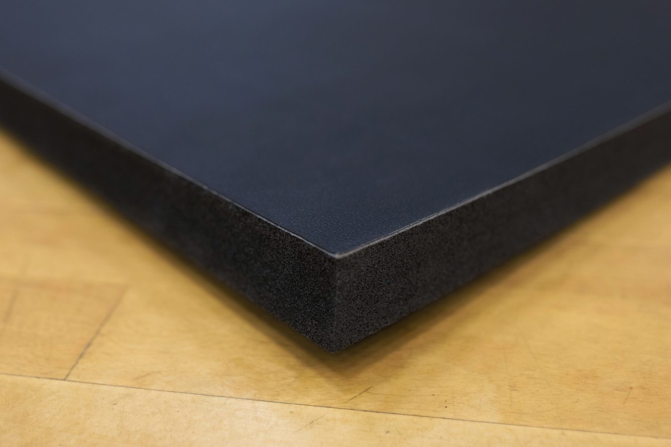 Corner of Black Promat PVC Smooth Roll Out Mats